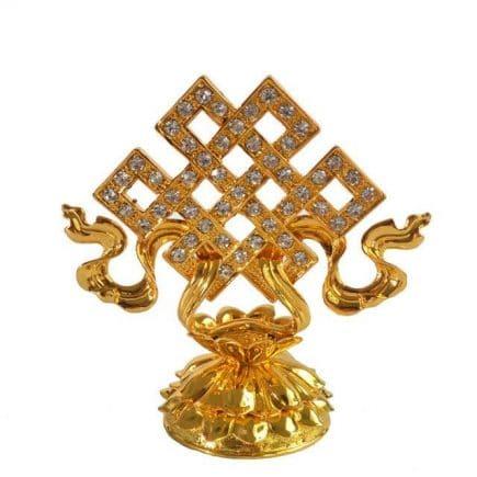 Statueta cu nod mistic auriu pe lotus, remediu feng shui pentru atragerea norocului