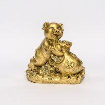Porc / mistret auriu pe monede, cu sacul abundentei, remediu Feng Shui pentru bunastare si prosperitate